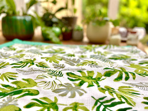 Close up of tropical leaf print on bamboo baby blanket