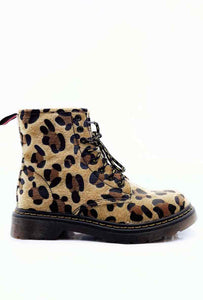 A side on image of a leopard print boot with black sole and laces