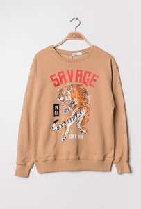 A beige coloured jumper with the word 'savage' printed in red letters, with a print of a tiger underneath.