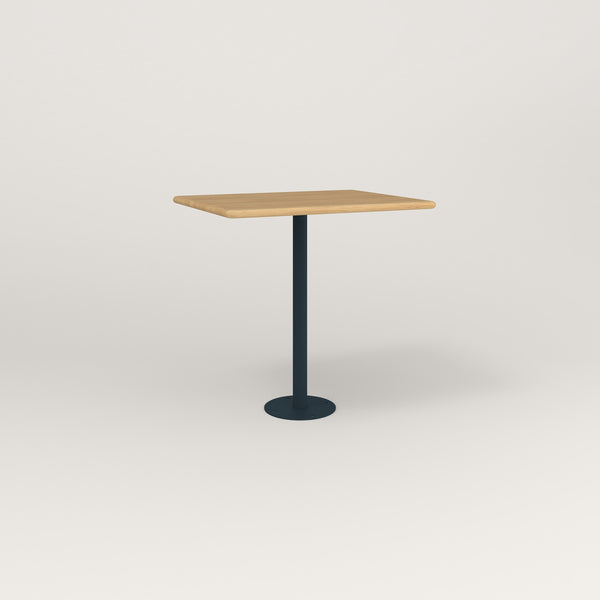 RAD Cafe Table, Rectangular Bolt Down Base in solid white oak and navy powder coat.