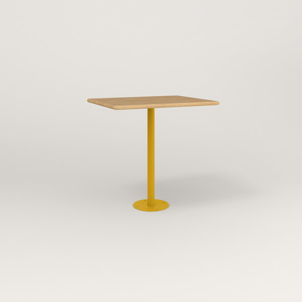 RAD Cafe Table, Rectangular Bolt Down Base in solid white oak and yellow powder coat.