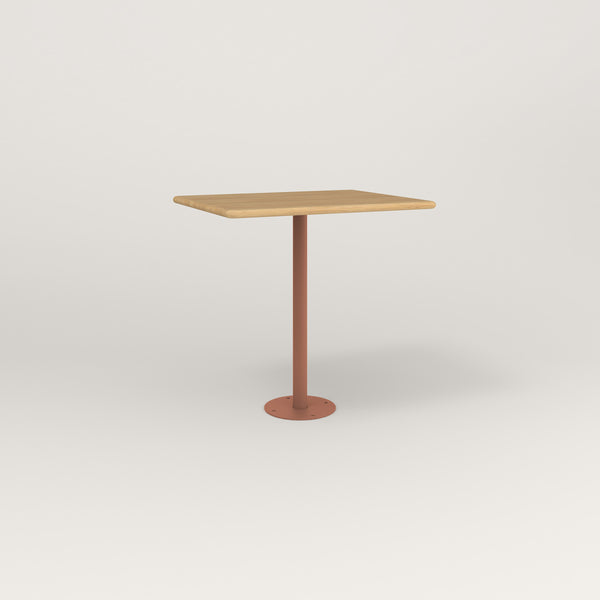 RAD Cafe Table, Rectangular Bolt Down Base in solid white oak and coral powder coat.