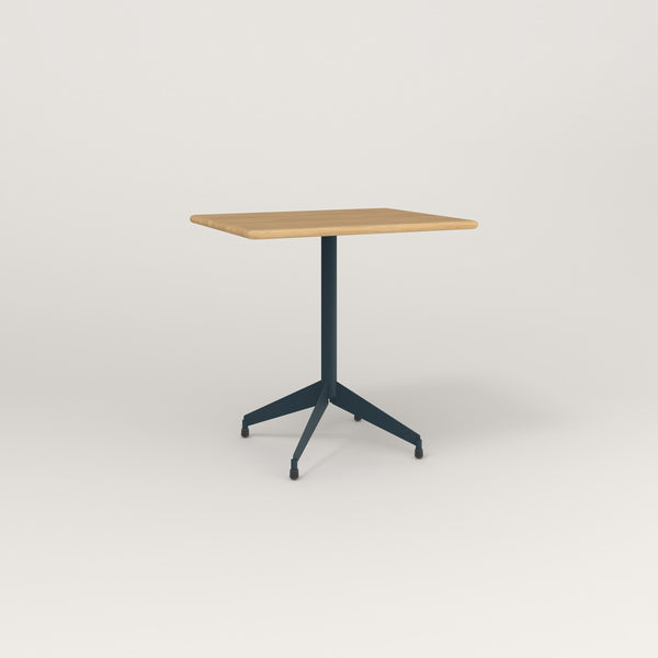 RAD Cafe Table, Rectangular Flat Four Point Base in solid white oak and navy powder coat.
