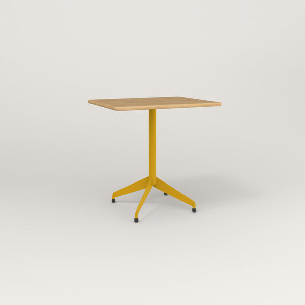 RAD Cafe Table, Rectangular Flat Four Point Base in solid white oak and yellow powder coat.
