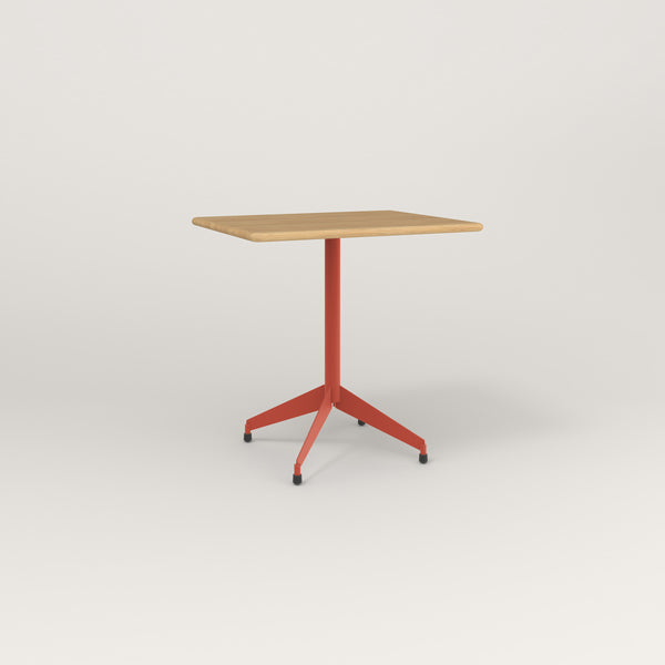 RAD Cafe Table, Rectangular Flat Four Point Base in solid white oak and red powder coat.