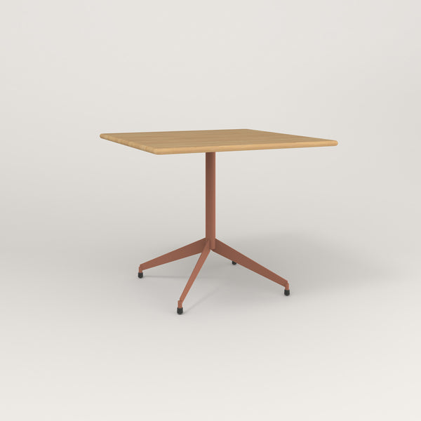 RAD Cafe Table, Rectangular Flat Four Point Base in solid white oak and coral powder coat.