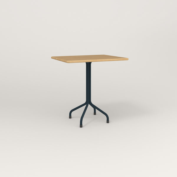 RAD Cafe Table, Rectangular Tube Four Point Base in solid white oak and navy powder coat.