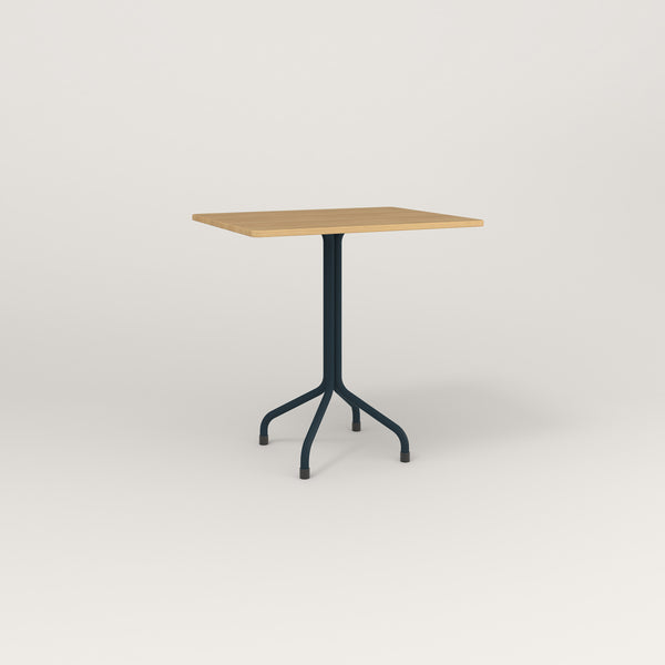 RAD Cafe Table, Rectangular Tube Four Point Base in white oak europly and navy powder coat.