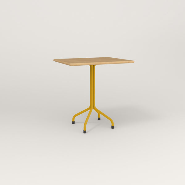 RAD Cafe Table, Rectangular Tube Four Point Base in solid white oak and yellow powder coat.