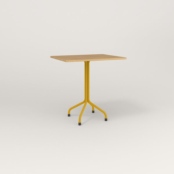RAD Cafe Table, Rectangular Tube Four Point Base in white oak europly and yellow powder coat.