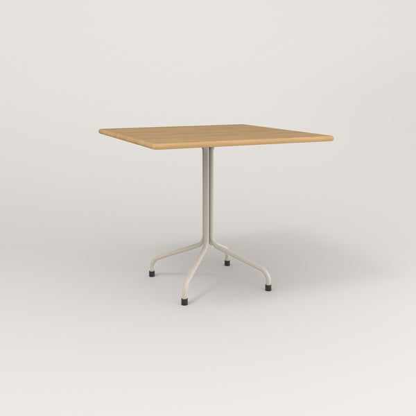RAD Cafe Table, Rectangular Tube Four Point Base in solid white oak and off-white powder coat.