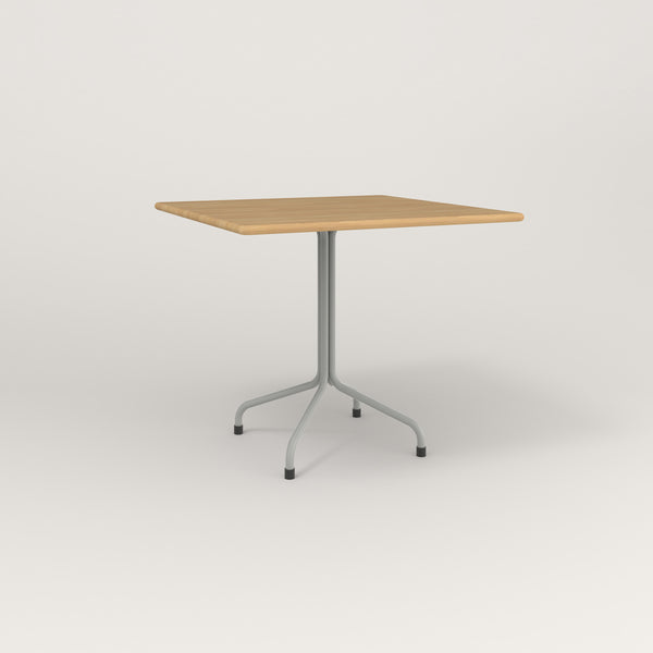 RAD Cafe Table, Rectangular Tube Four Point Base in solid white oak and grey powder coat.