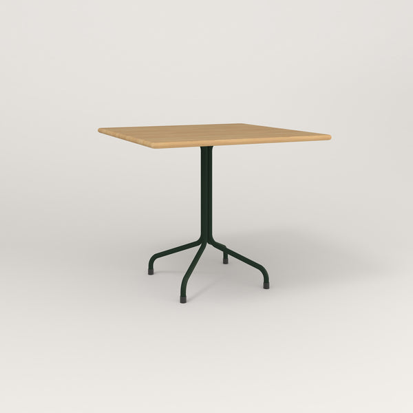 RAD Cafe Table, Rectangular Tube Four Point Base in solid white oak and fir green powder coat.