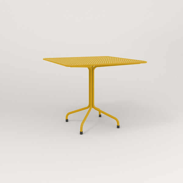 RAD Cafe Table, Rectangular Tube Four Point Base in perforated steel and yellow powder coat.