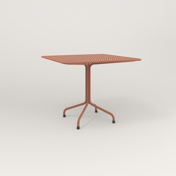 RAD Cafe Table, Rectangular Tube Four Point Base in perforated steel and coral powder coat.