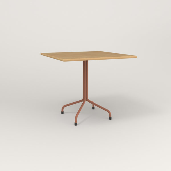RAD Cafe Table, Rectangular Tube Four Point Base in solid white oak and coral powder coat.