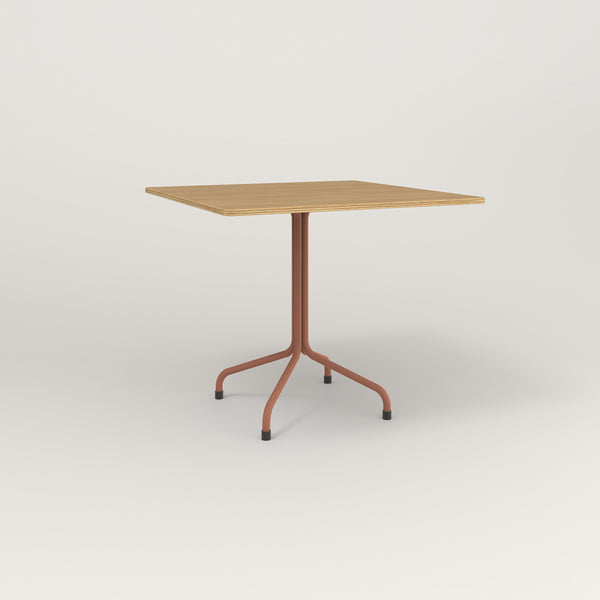 RAD Cafe Table, Rectangular Tube Four Point Base in white oak europly and coral powder coat.