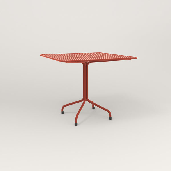 RAD Cafe Table, Rectangular Tube Four Point Base in perforated steel and red powder coat.