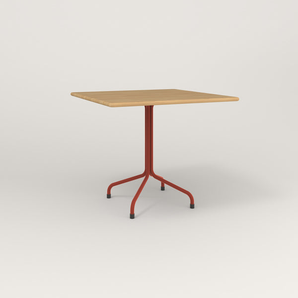 RAD Cafe Table, Rectangular Tube Four Point Base in solid white oak and red powder coat.