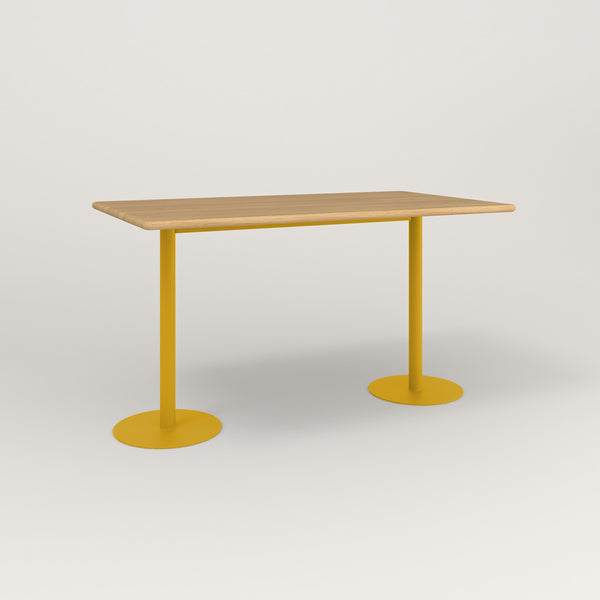 RAD Cafe Table, Rectangular Weighted Base T Leg in solid white oak and yellow powder coat.