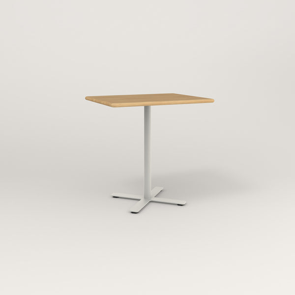 RAD Cafe Table, Rectangular X Base in solid white oak and white powder coat.