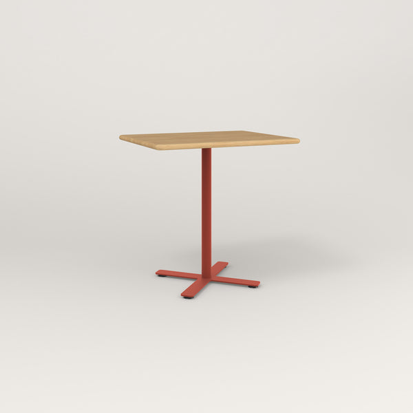 RAD Cafe Table, Rectangular X Base in solid white oak and red powder coat.