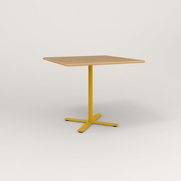 RAD Cafe Table, Rectangular X Base in solid white oak and yellow powder coat.