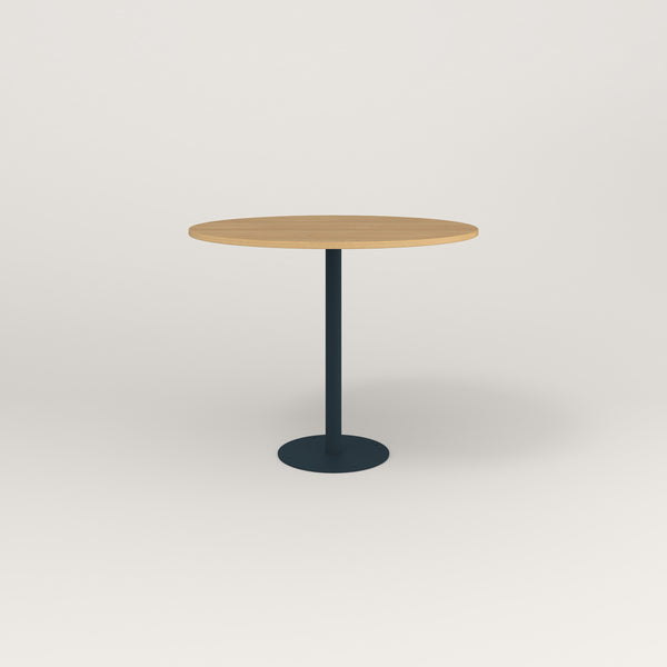 RAD Cafe Table, Round Bolt Down Base in white oak europly and navy powder coat.