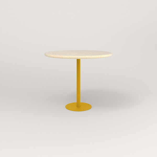 RAD Cafe Table, Round Bolt Down Base in solid ash and yellow powder coat.