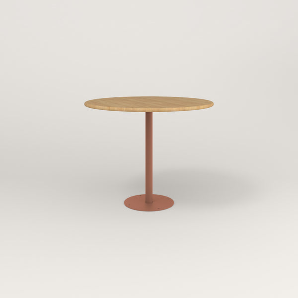 RAD Cafe Table, Round Bolt Down Base in solid white oak and coral powder coat.