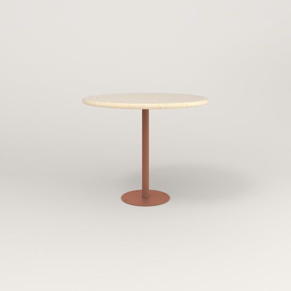 RAD Cafe Table, Round Bolt Down Base in solid ash and coral powder coat.