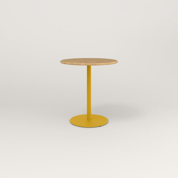 RAD Cafe Table, Round Weighted Base in solid white oak and yellow powder coat.
