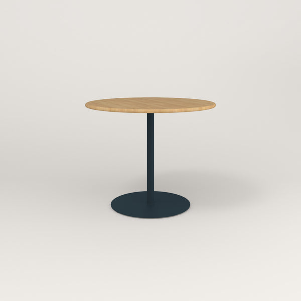 RAD Cafe Table, Round Weighted Base in solid white oak and navy powder coat.
