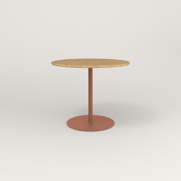 RAD Cafe Table, Round Weighted Base in solid white oak and coral powder coat.