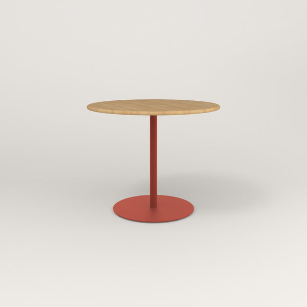 RAD Cafe Table, Round Weighted Base in solid white oak and red powder coat.