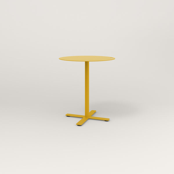 RAD Cafe Table, Round X Base in aluminum and yellow powder coat.