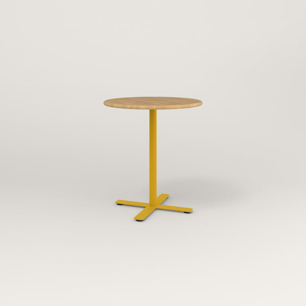 RAD Cafe Table, Round X Base in solid white oak and yellow powder coat.