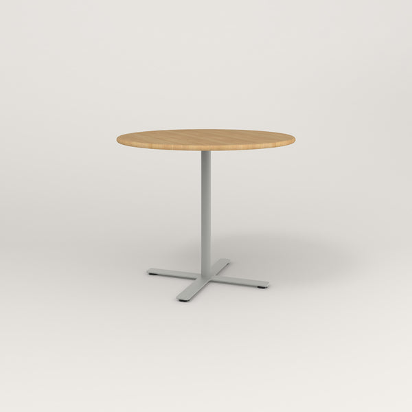 RAD Cafe Table, Round X Base in solid white oak and grey powder coat.