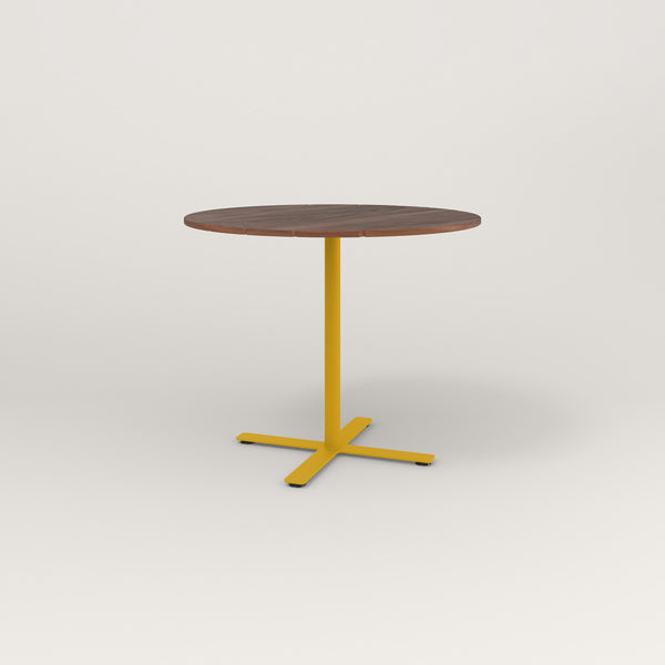 RAD Cafe Table, Round X Base in slatted wood and yellow powder coat.