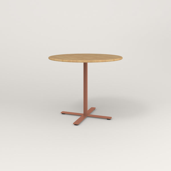 RAD Cafe Table, Round X Base in solid white oak and coral powder coat.