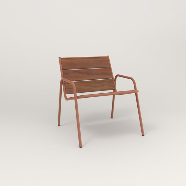 RAD Signature Lounge Chair in slatted wood and coral powder coat.