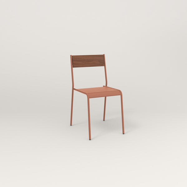 RAD Signature Dining Chair in slatted wood and coral powder coat.