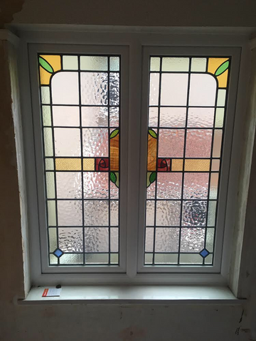 Art Deco stained glass window in victorian home