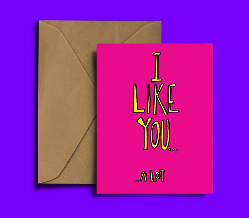 Glass Designs Dixon Does Doodles card with a pink background and yellow writing saying i like you a lot