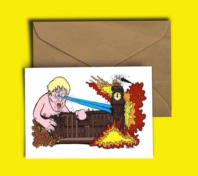 Glass Designs Dixon Does Doodles card with a picture of giant Boris Johnson blowing up the houses of parliment with his lazer eyes