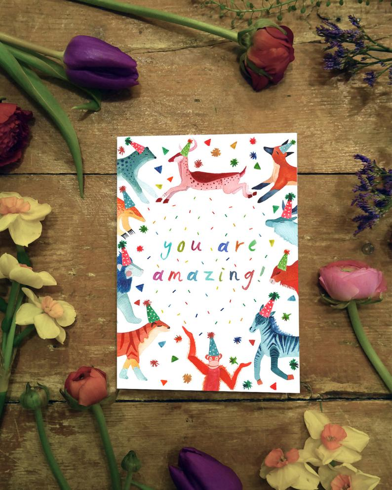watercolour greetings card with animals in party hats and the words ''you are amazing''