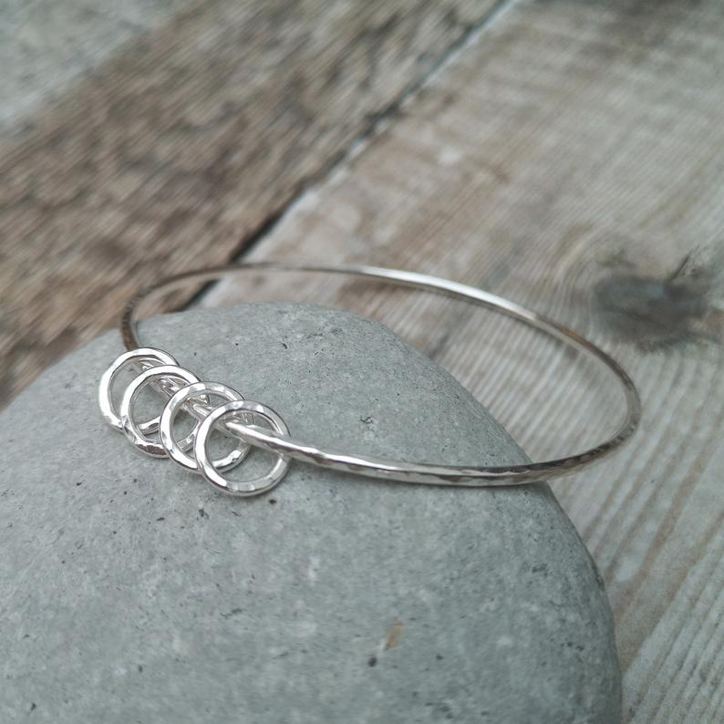 Glass Designs Jewellery By Jo beautiful hammered finish bangle with 4 smaller rings threaded on