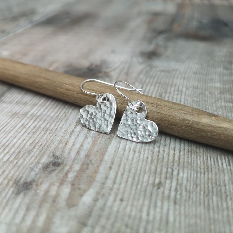 Glass Designs Jewellery By Jo small hammered finish silver heart shaped dangly earrings
