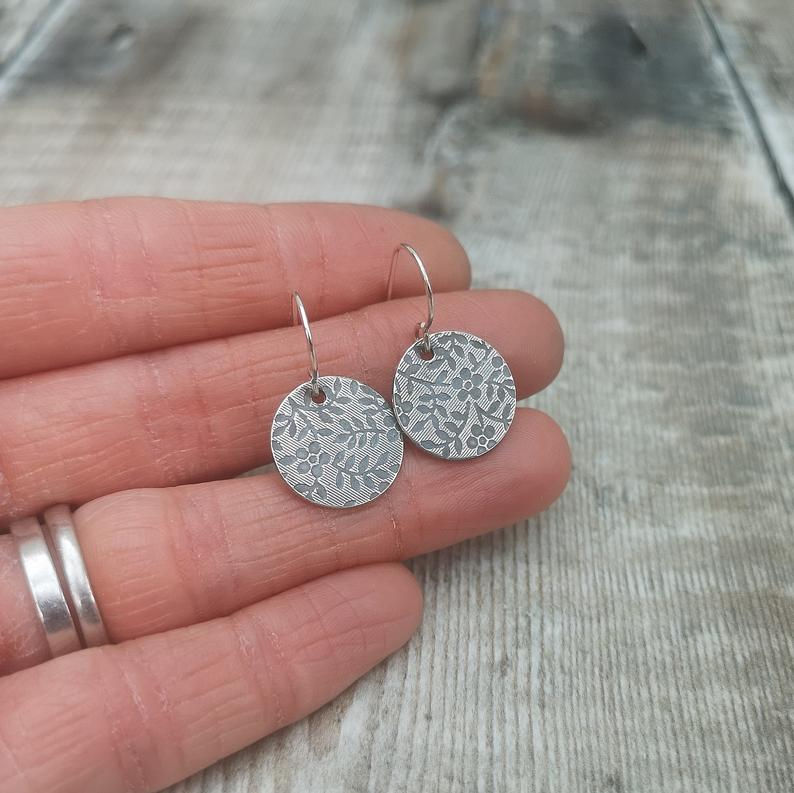 Glass Designs Jewellery By Jo silver circles stamped with delicate flower repeating pattern