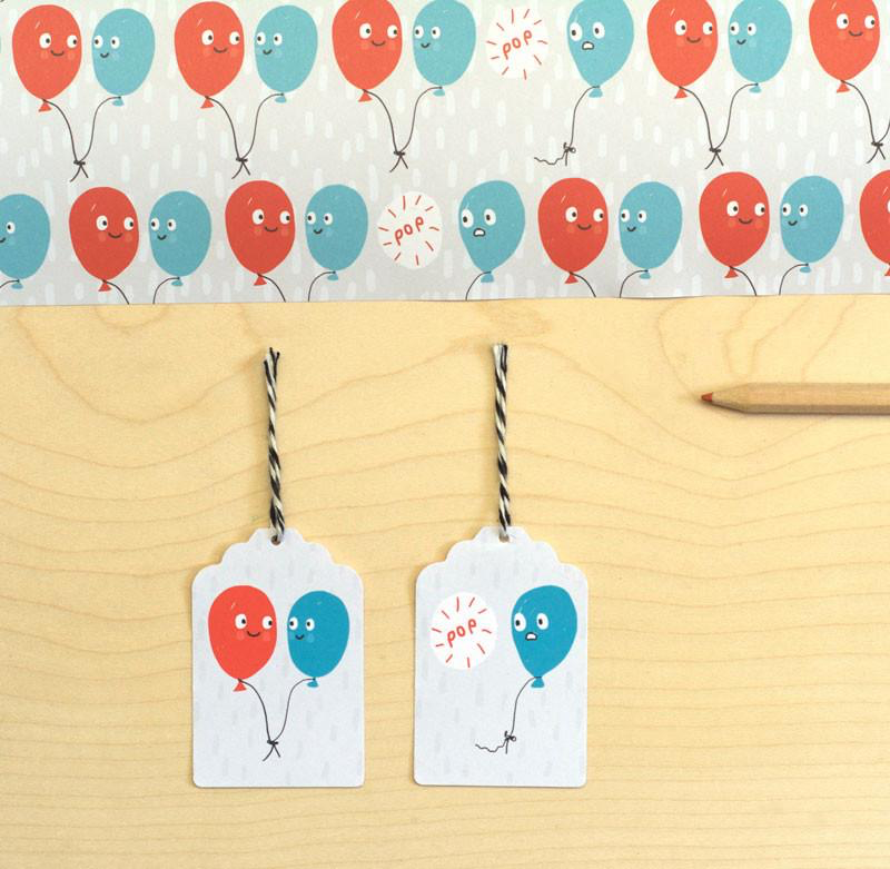 Sarah Ray Whimsical Wrapping Paper.  Blue and Red Party Balloons with smiling faces.  Suitable for Birthday and Celebrations.